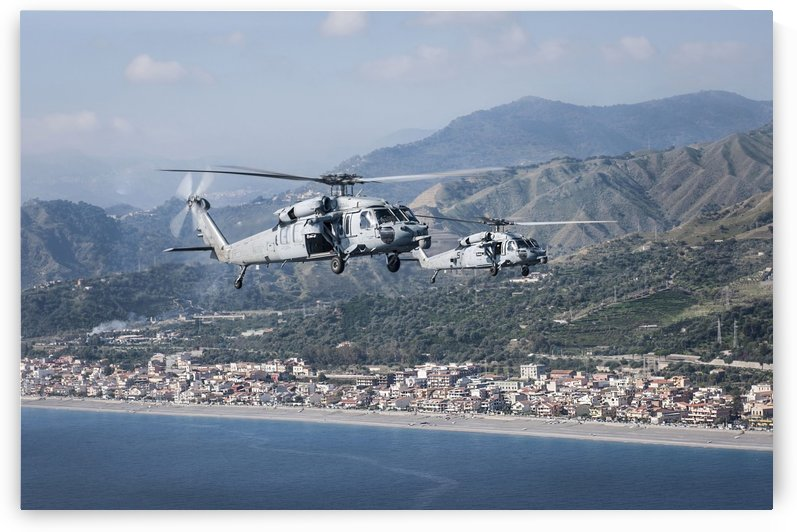 MH-60S Sea Hawk helicopters off the coast of Naples Italy. by StocktrekImages