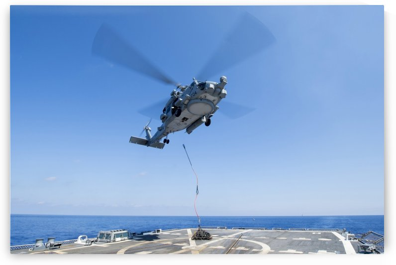 An SH-60R Seahawk delivers supplies during a vertical replenishment. by StocktrekImages