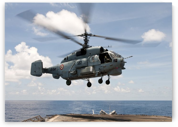 An Indian Navy Kamov Ka-31  lands on the flight deck of USS Bunker Hill. by StocktrekImages