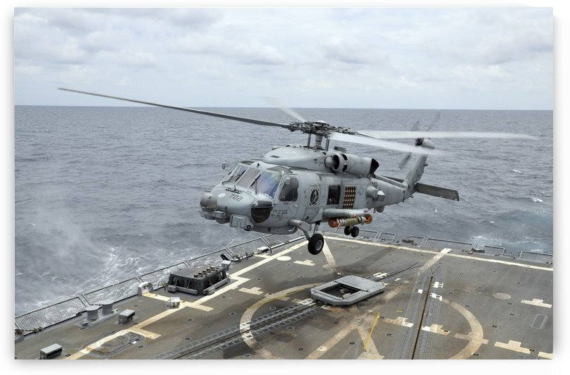 An MH-60R Sea Hawk helicopter lifts off from USS Wayne E. Meyer. by StocktrekImages