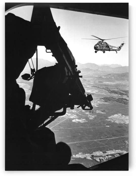 Helicopter and soldier approaching target in Vietnam. by StocktrekImages