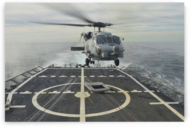 An MH-60R Sea Hawk helicopter lands aboard USS Halyburton. by StocktrekImages
