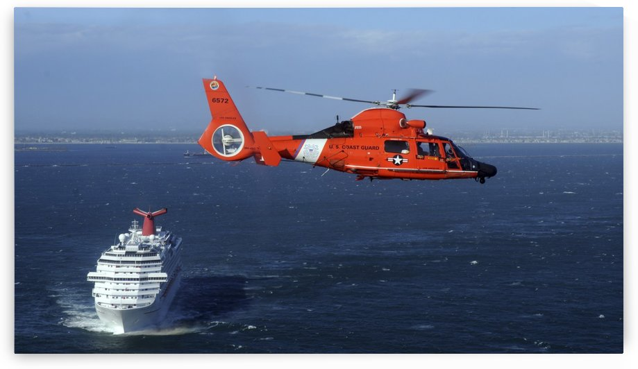 A MH-65C Dolphin helicopter off the coast of San Pedro California. by StocktrekImages