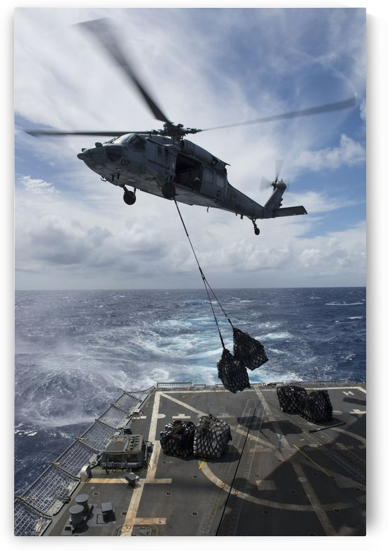 An SH-60S Sea Hawk delivers supplies on the flight deck fo USS Preble. by StocktrekImages
