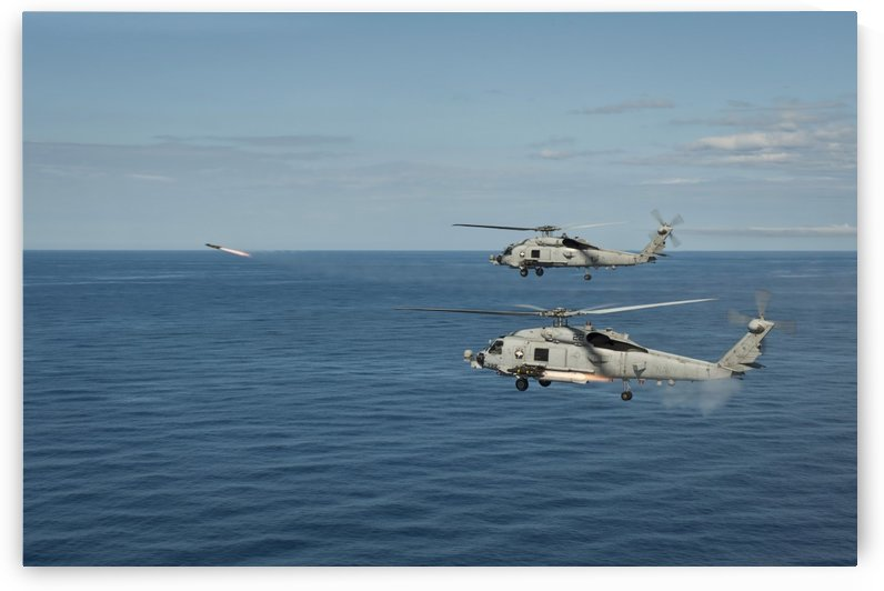 MH-60R Sea Hawk helicopters launch AGM-114 hellfire missiles. by StocktrekImages