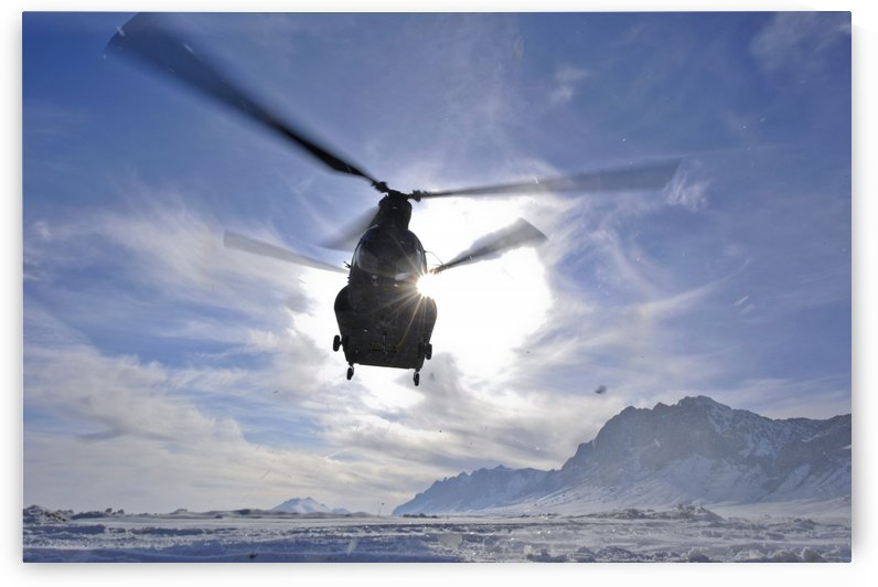 A CH-47 Chinook helicopter takes off from a remote landing zone. by StocktrekImages