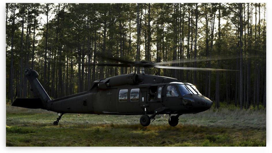 An HH-60 Pave Hawk evacuates injured patients. by StocktrekImages