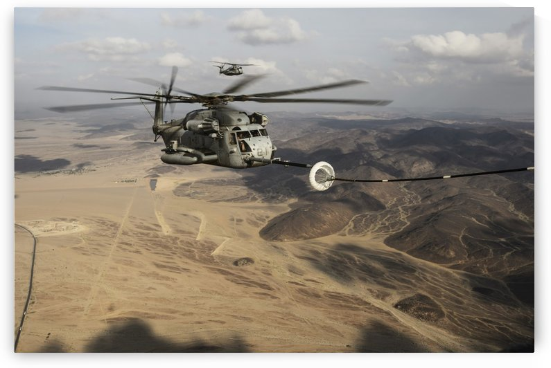 A U.S. Marine Corps CH-53E Super Stallion refueling over the Horn of Africa. by StocktrekImages