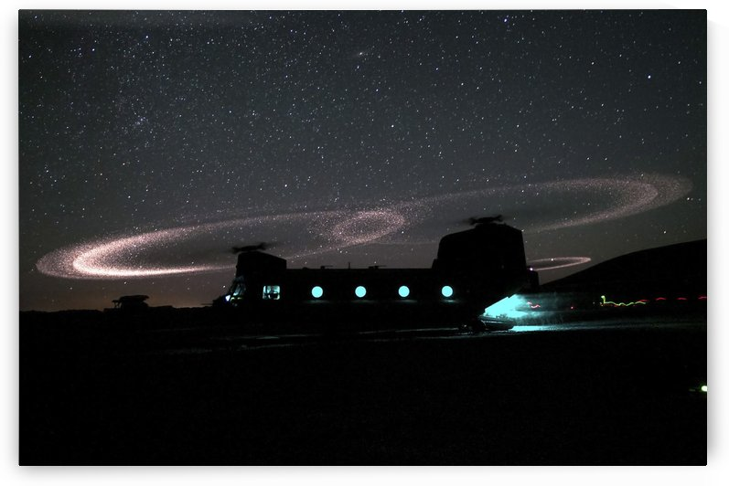Dust lights up the rotors of a CH-47 Chinook helicopter. by StocktrekImages