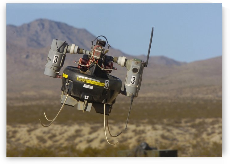 A Micro Air Vehicle flies over a simulated combat area. by StocktrekImages