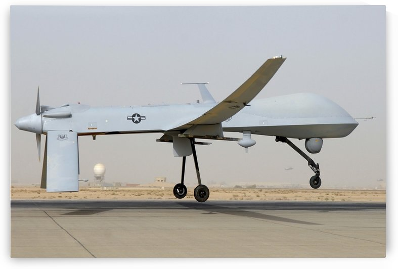 An MQ-1 Predator prepares for takeoff. by StocktrekImages