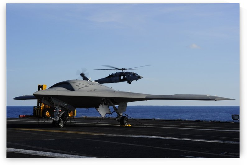 The X-47B Unmanned Combat Air System aboard USS Harry S. Truman. by StocktrekImages