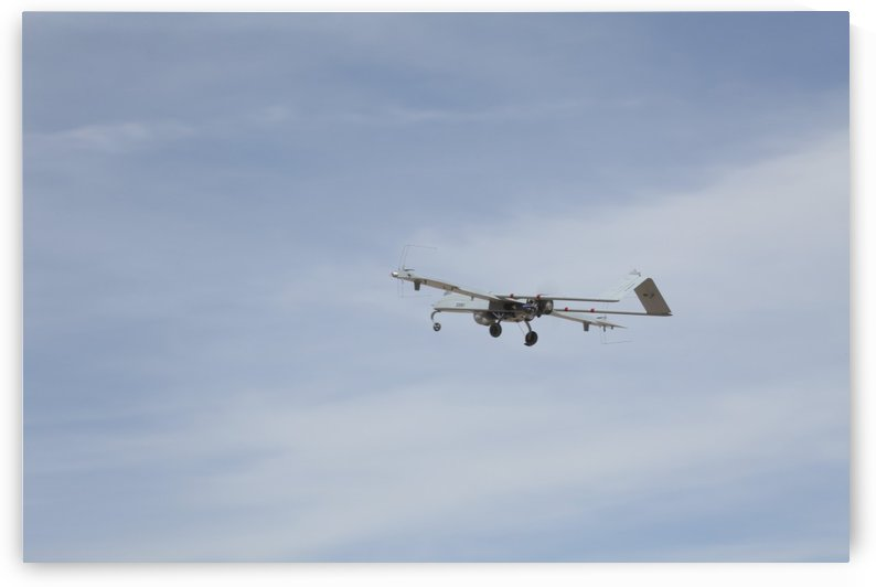 An RQ-7 Shadow unmanned aerial vehicle in flight. by StocktrekImages