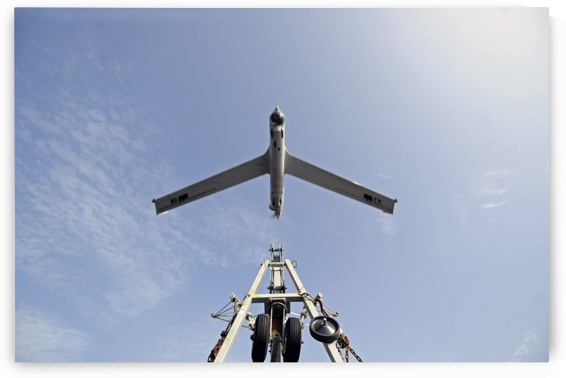 A ScanEagle unmanned aerial vehicle launches from its catapult. by StocktrekImages