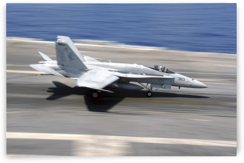 An F-A-18E Super Hornet lands aboard USS Dwight D. Eisenhower. by StocktrekImages
