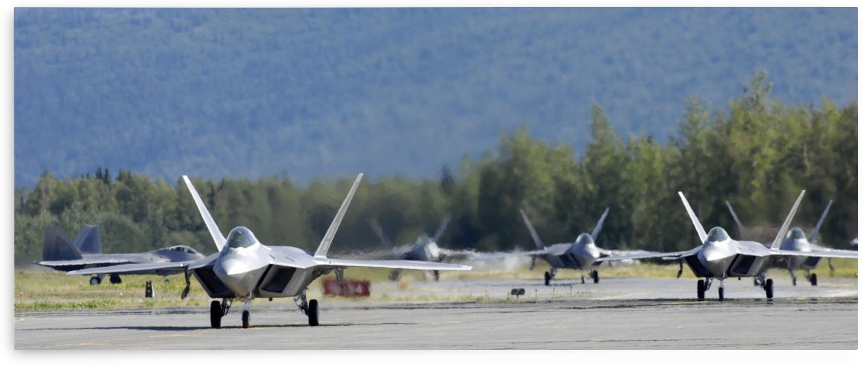Six F-22 Raptors taxi down the runway. by StocktrekImages