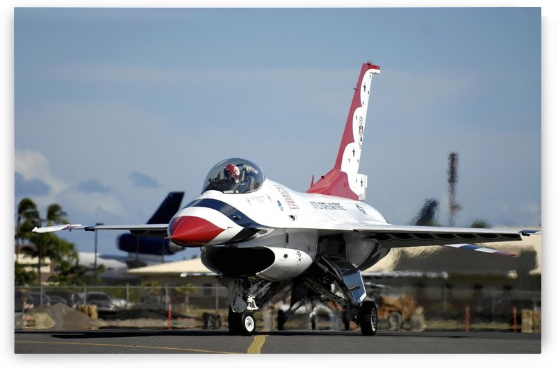 A Thunderbird taxies to its parking spot. by StocktrekImages