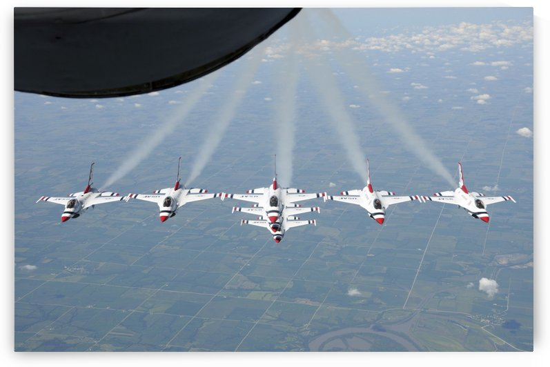 The U.S. Air Force Thunderbird demonstration squadron in formation. by StocktrekImages