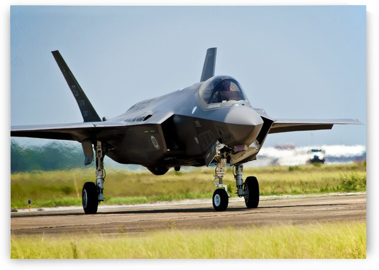 An F-35 Lightning II taxiing at Eglin Air Force Base Florida. by StocktrekImages