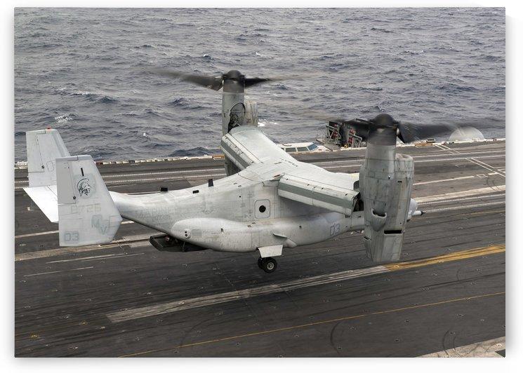 A V-22 Osprey lands aboard the aircraft carrier USS Harry S. Truman. by StocktrekImages
