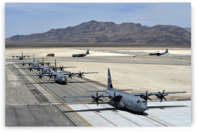 Seven C-130J Super Hercules taxiing at Creech Air Force Base. by StocktrekImages