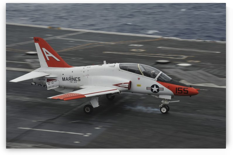 A T-45C Goshawk lands aboard USS George H.W. Bush. by StocktrekImages