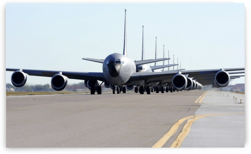 KC-135 Stratotankers in Elephant Walk formation on the runway. by StocktrekImages