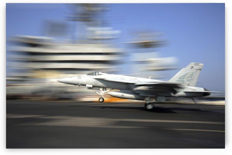 An F-A-18E Super Hornet lands aboard USS Dwight D. Eisenhower. by StocktrekImages