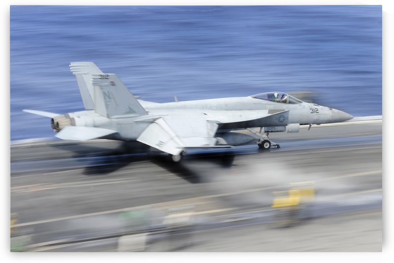 An F-A-18E Super Hornet launches from the aircraft carrier USS George Washington. by StocktrekImages