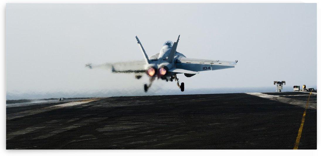 An F-A-18F Super Hornet launches off the flight deck of USS John C. Stennis. by StocktrekImages