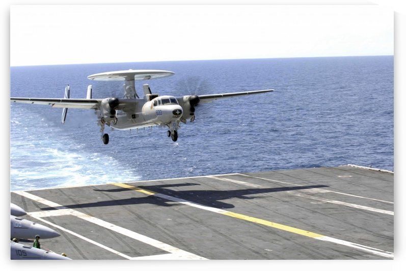 An E-2C Hawkeye makes its approach to the flight deck of USS Dwight D. Eisenhower. by StocktrekImages