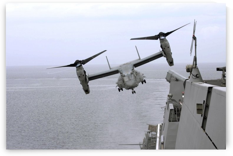 An MV-22B Osprey takes off from the amphibious transport dock ship USS Mesa Verde. by StocktrekImages