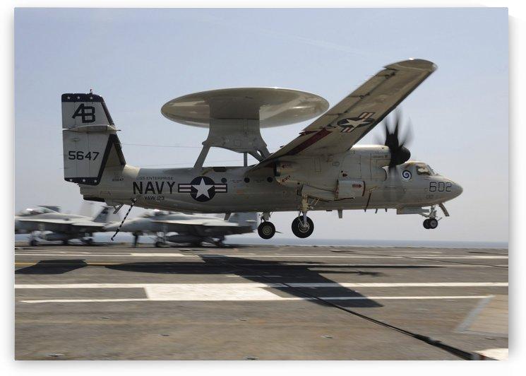 An E-2C Hawkeye lands aboard the aircraft carrier USS Enterprise. by StocktrekImages