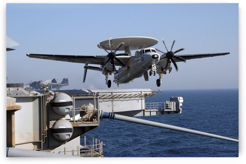 An E-2C Hawkeye launches off the flight deck of USS Nimitz. by StocktrekImages