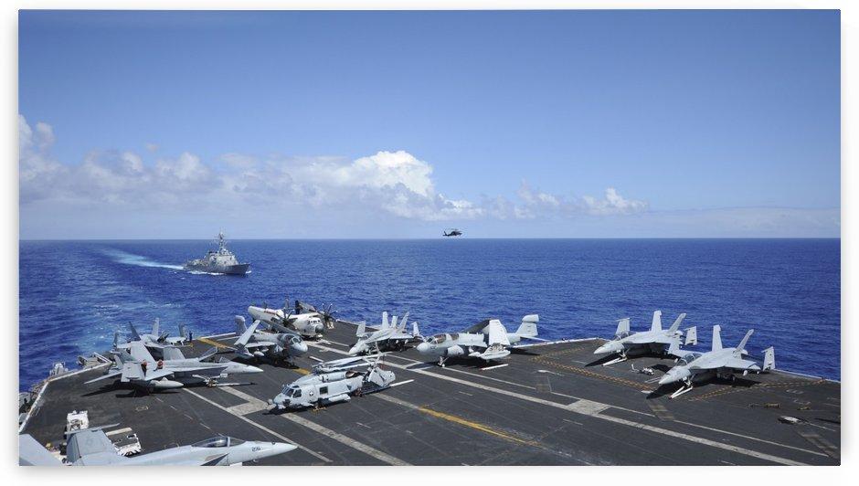 Aircraft arranged on the flight deck of aircraft carrier USS Nimitz. by StocktrekImages