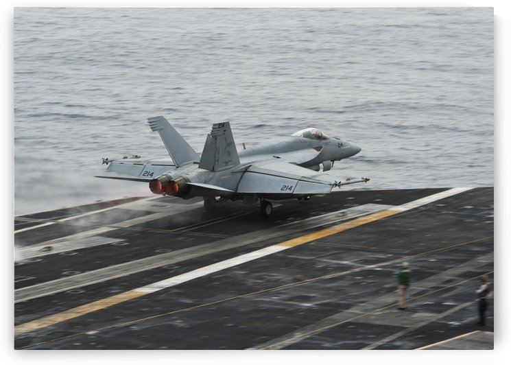 An F-A-18E Super Hornet launches from the flight deck of USS Nimitz. by StocktrekImages