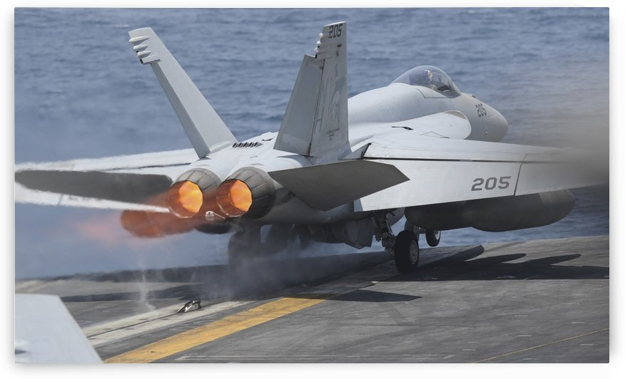An F-A-18E Super Hornet launches from USS Nimitz. by StocktrekImages