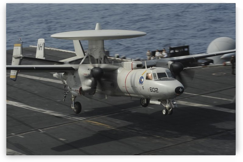 An E-2C Hawkeye lands aboard the aircraft carrier USS Nimitz. by StocktrekImages