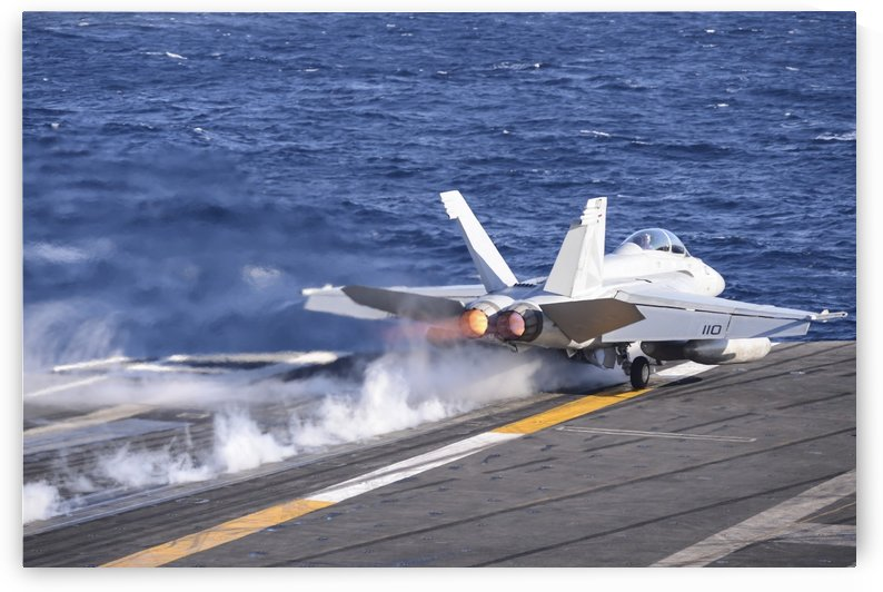 An F-A-18F Super Hornet launches from USS Nimitz. by StocktrekImages