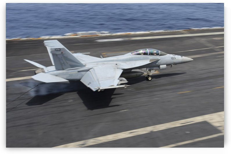 An F-A-18F Super Hornet lands on the flight deck of USS Nimitz. by StocktrekImages