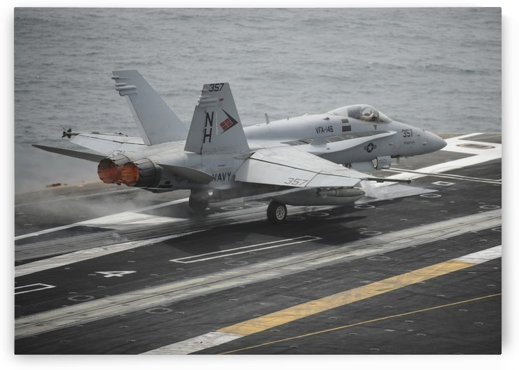 An F-A-18C Hornet launches from the aircraft carrier USS Nimitz. by StocktrekImages