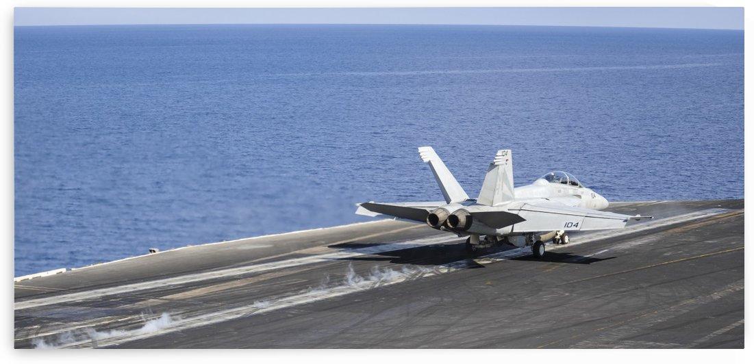 An F-A-18F Super Hornet launches off the flight deck of USS Nimitz. by StocktrekImages