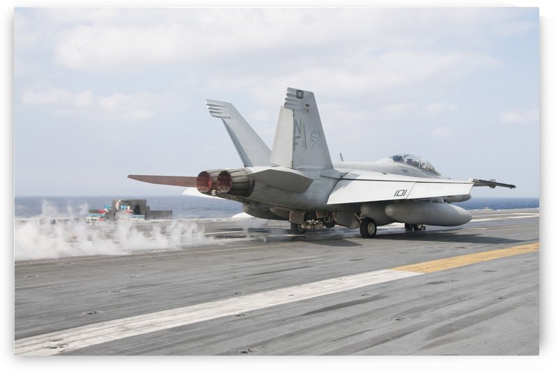 An F-A-18F Super Hornet launches from the flight deck of USS George Washington. by StocktrekImages