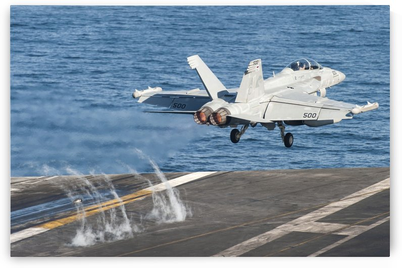 An EA-18G Growler launches from the flight deck of USS Harry S. Truman. by StocktrekImages