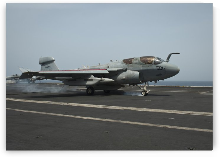 An EA-6B Prowler lands on the flight deck of USS Nimitz. by StocktrekImages