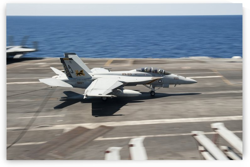 An FA-18F Super Hornet lands aboard USS George H.W. Bush. by StocktrekImages