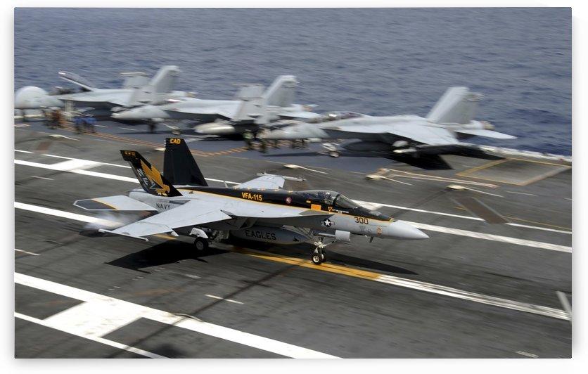 An F-A-18E Super Hornet makes an arrested landing. by StocktrekImages