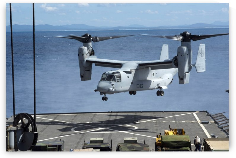 An MV-22 Osprey lands on the flight deck of USS Germantown. by StocktrekImages