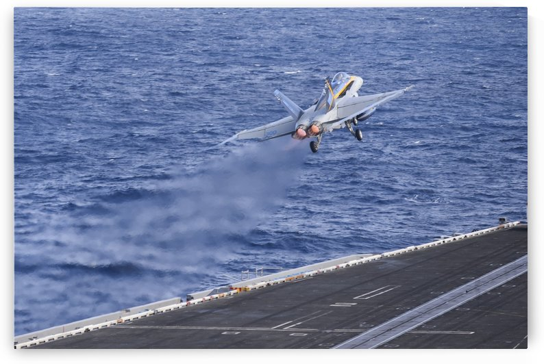 An F-A-18C Hornet launches from USS Nimitz. by StocktrekImages
