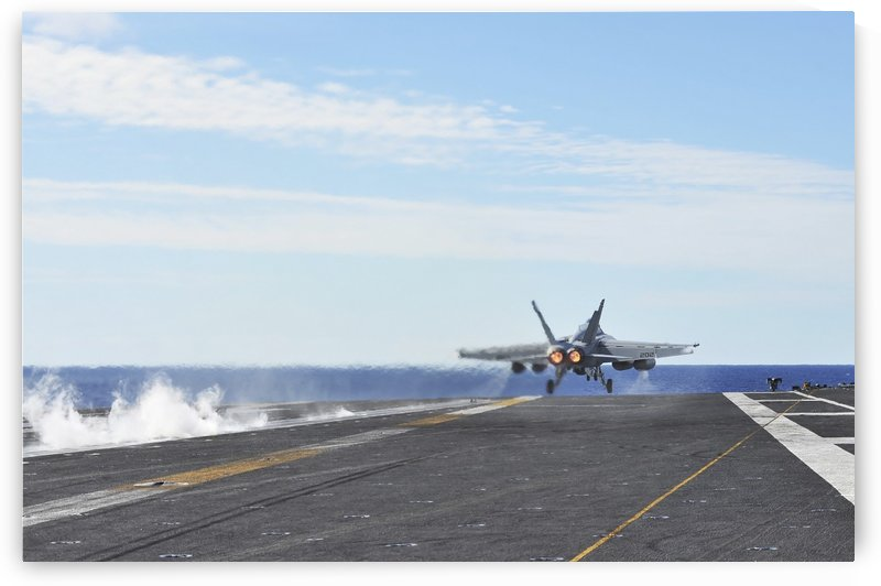 An F-A-18E Super Hornet launches from the flight deck of USS George Washington. by StocktrekImages